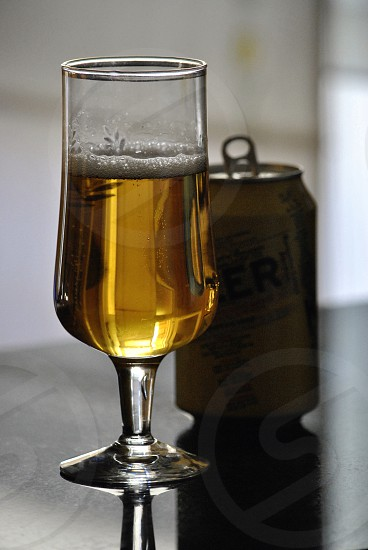 beer in clear short stemmed wine glass photo