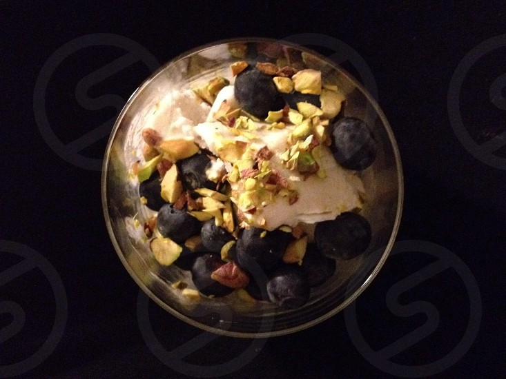 Homemade cocoanut ice cream with pistachios and blueberries  photo