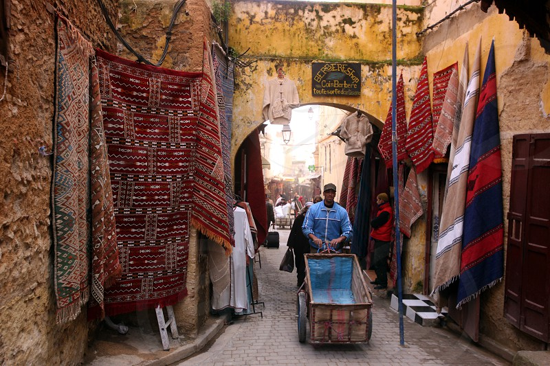 a smal Marketroad in the Medina of old City in the historical Town of Fes in Morocco in north Africa. photo