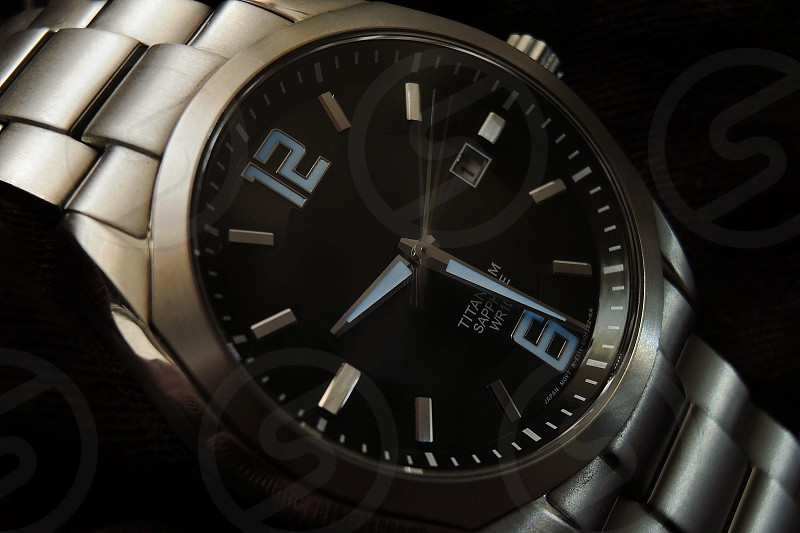 silver titanium watch read out 09:29 photo