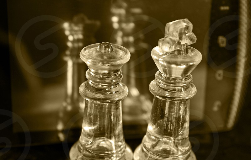 chess pieces smart phone reflection king queen photo