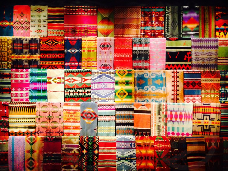 multicolored textiles on display photo