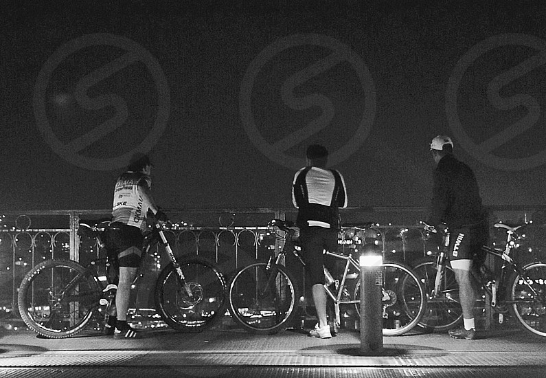 Cyclists enjoying the view from the bridge  photo