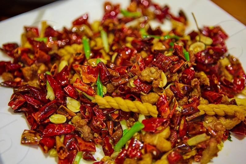 chili dish on white plate photo