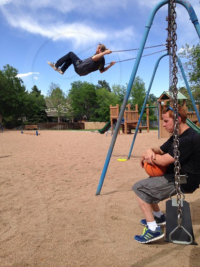 Boys on swings photo