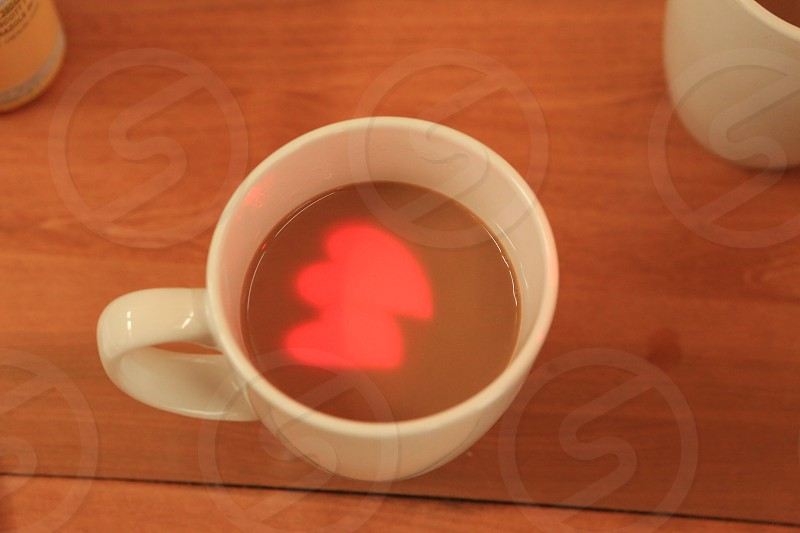 Cup of Coffee Light painting Hearts in coffee  photo