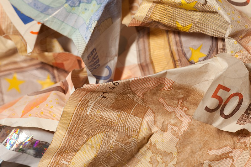 Financial crisis crumpled euro bills closeup currency crisis concept background pattern photo