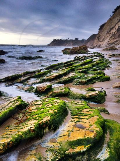 mountain cliff along sea photography photo