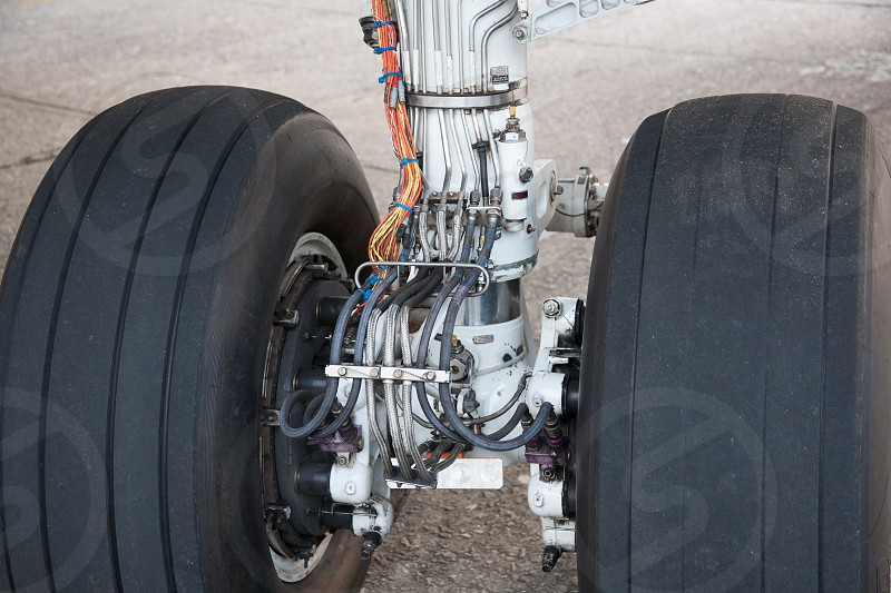 landing gear plane airplane flight travel airport airliner wheel cables photo