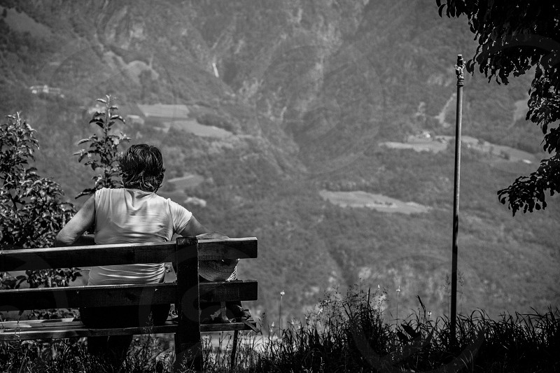 black and white women sitting inspirational postcard mountain waiting emotional photo
