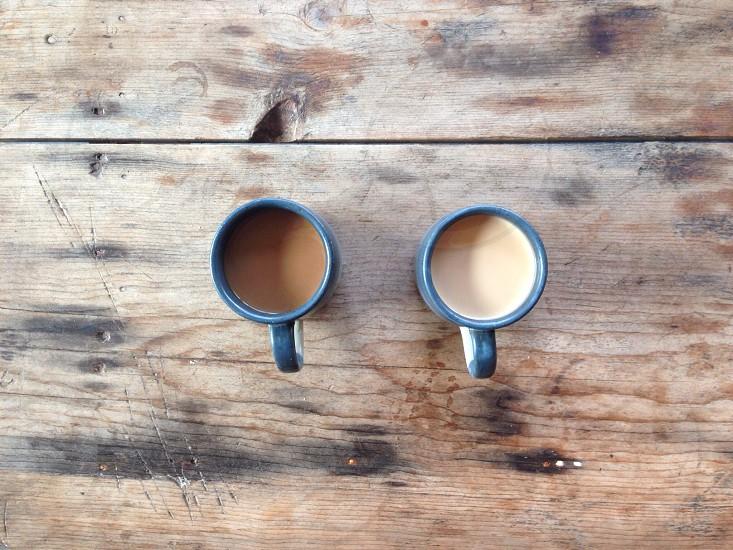 2 blue and white ceramic coffee mug photo