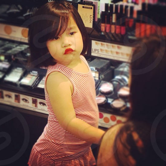 Little girl with make up photo
