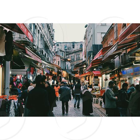 people walking on market place photo