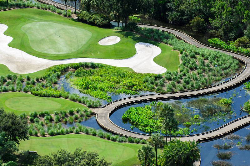 An elaborate golf green in Florida.  Taken by helicopter at 500 feet. photo
