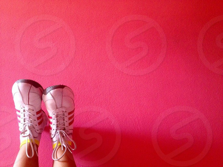pair of white-and-red Adidas lace-up low-top sneakers photo