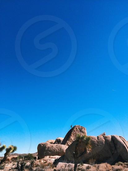 person stone climbing photo