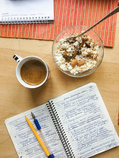 Keeping healthy body and mind. Healthy breakfast with writing a diary with daily plans. photo