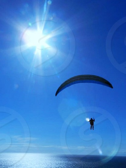 Man paragliding at Fort Ebey on Whidbey Island Washington photo