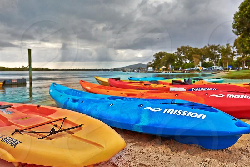assorted kayaks on seashore photo