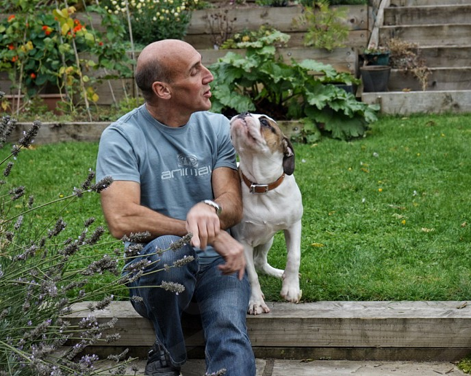 Man and his dog hanging out together photo