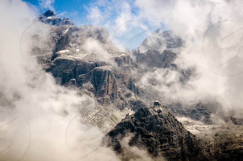 Beautiful mountains and blue sky through the clouds photo