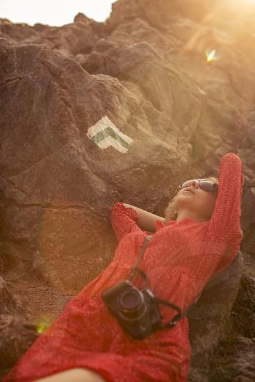 Relax. Young woman lying on mountain in Zakopane Poland photo