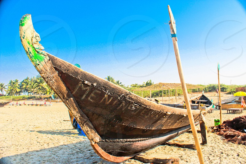 Fishing boat on the beach Goa India photo