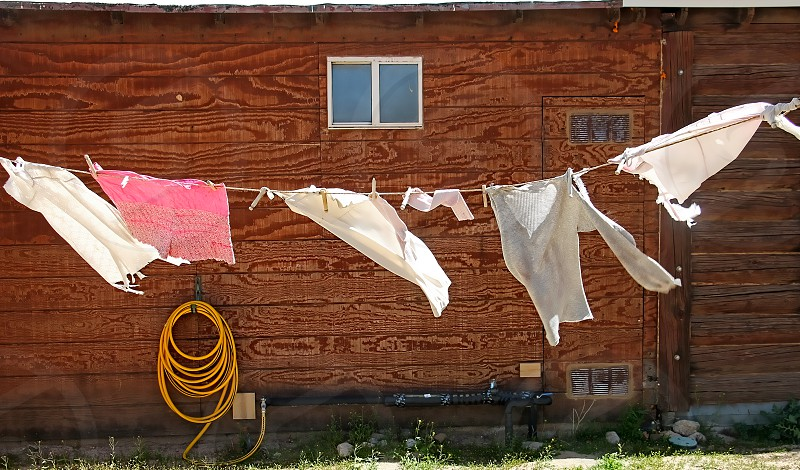 Laundry drying on a clothesline blows in the wind. photo
