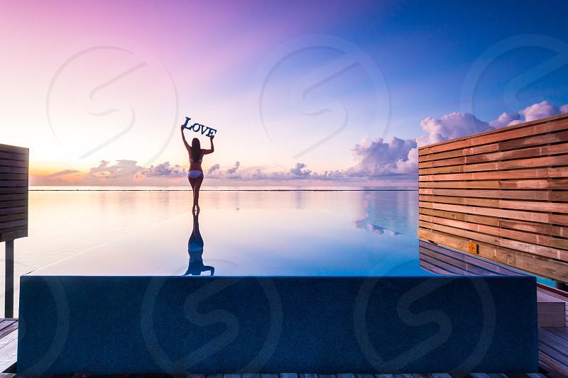 Maldives travel wanderlust luxury vacation  sunset  swimming pool  cloud  portrait  love  photo