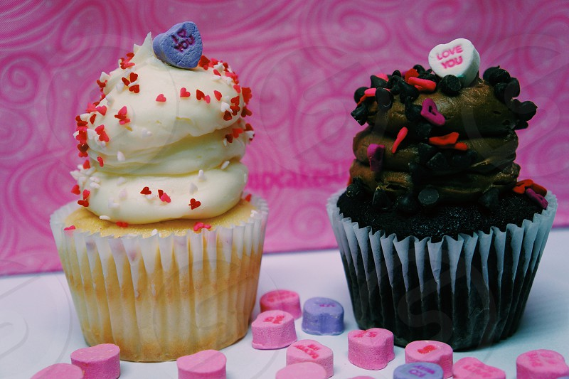 cupcake with white frosting by chocolate cupcake photo
