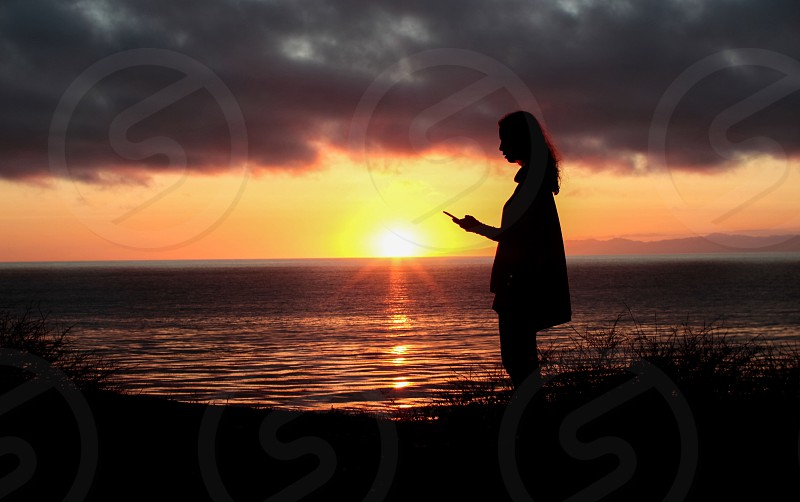 photography of silhouette woman with sunset on background photo