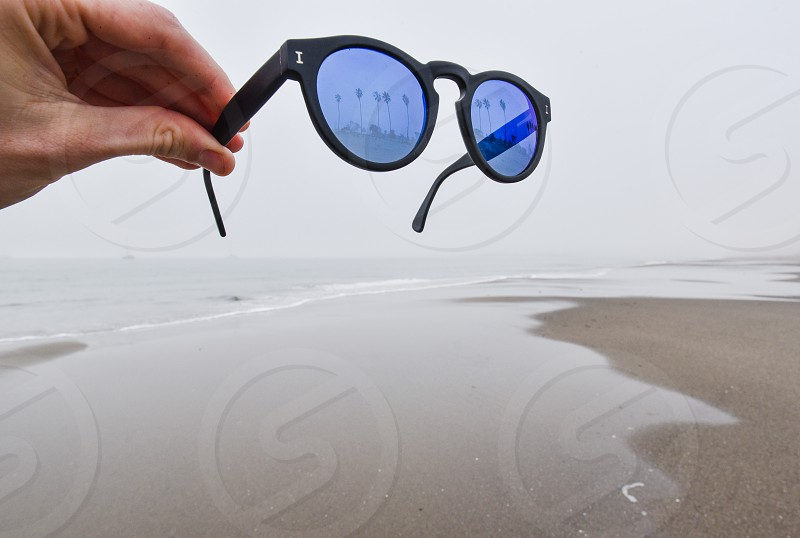 illesteva sunglasses reflective lens blue palm trees beach fog photo