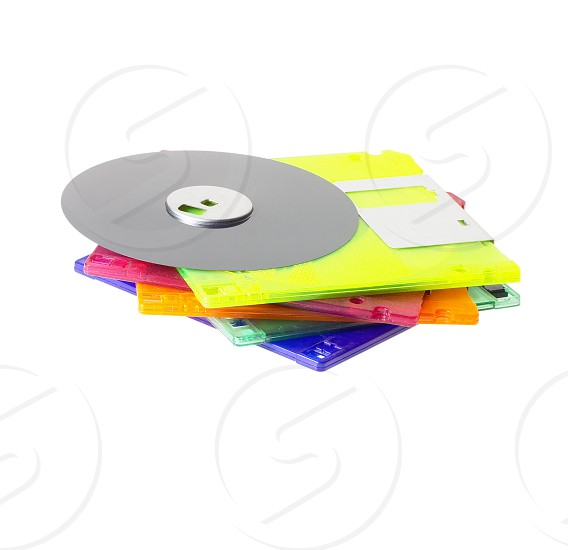 coulorfull plastic floppy disk on white background photo