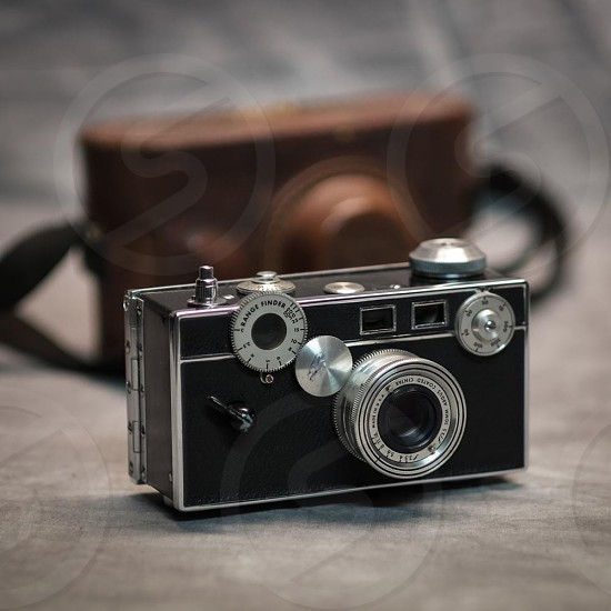 black and silver vintage camera photo