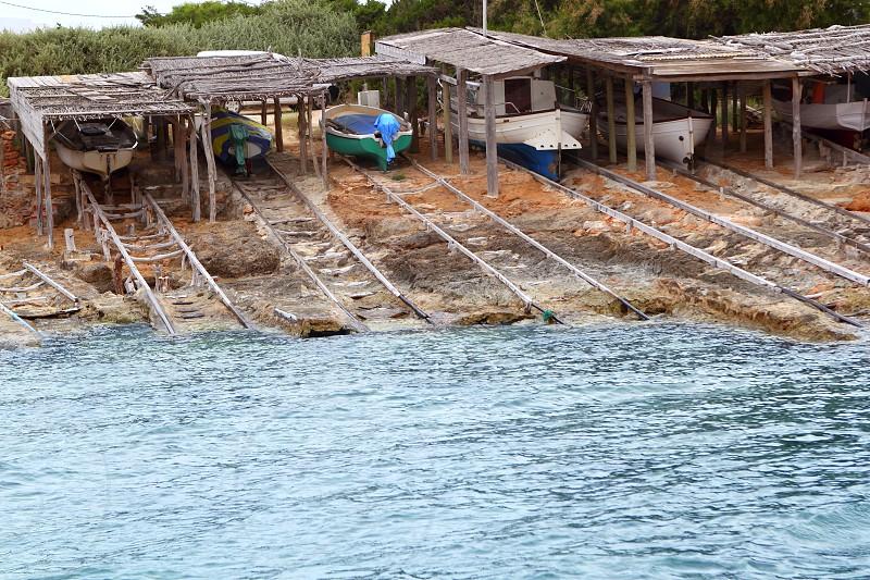 Escalo Formentera boat stranded wooden rails Balearic Islands photo