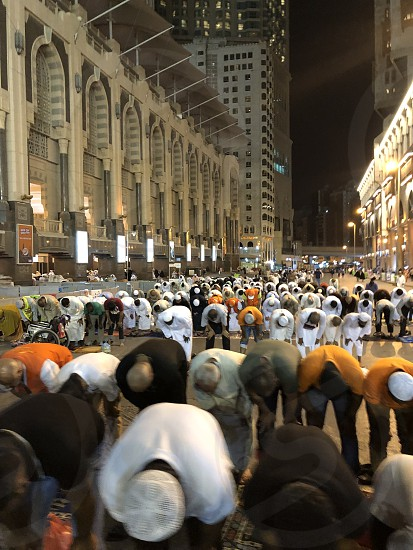 Mecca Makkah. Saudi Arabia. Muslim pilgrims during prayer.  photo