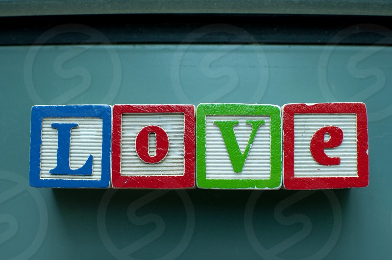 Love written on colorful toy blocks photo