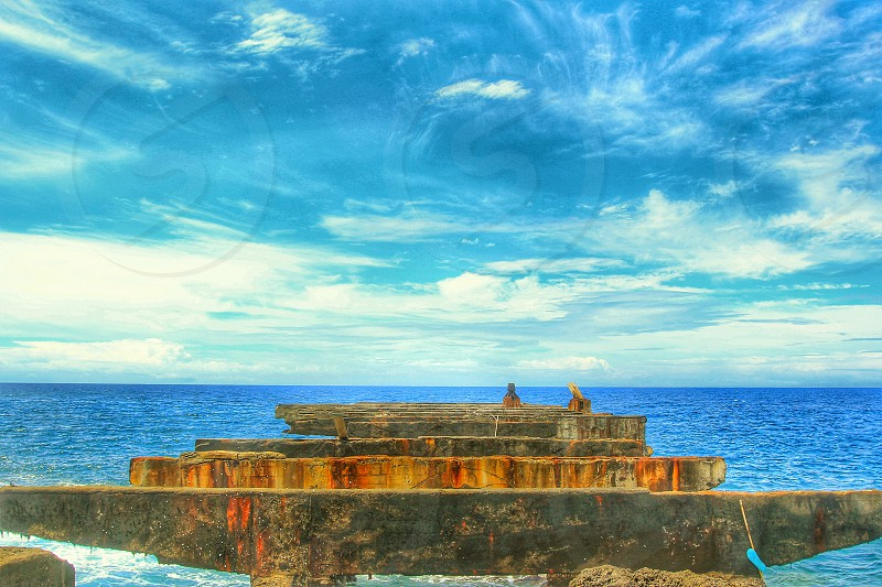 Historic Pier at Whittington Beach in Naalehu Hawaii. The park at Whittington Beach offers a beautiful view of the ocean and lava fields and tables for picnics. Whittington beach Hawaii big island photo
