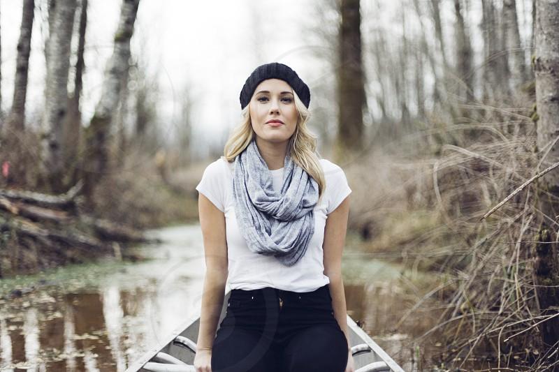 Blonde Woman Wearing Black Hat Sitting in Canoe photo