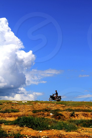 motorcycle vietnam clouds nature open road photo