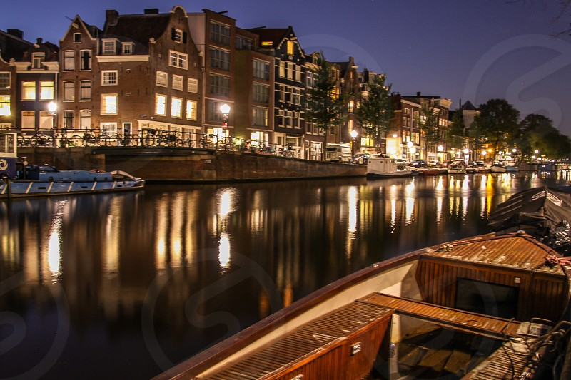 Netherlands Holland Amsterdam canal boat night lights reflection buildings  photo