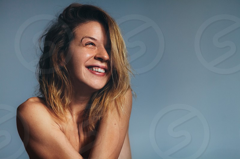 Portrait of beautiful young woman smiling photo