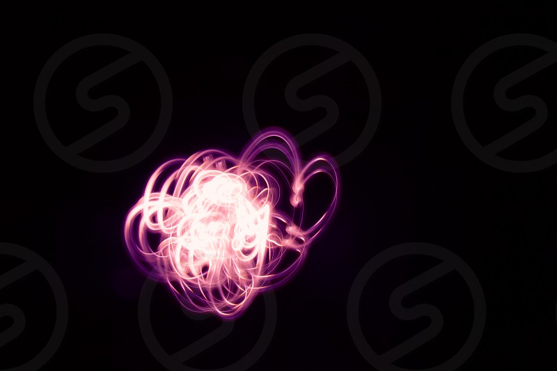 Flower shaped glowing abstract curved lines. photo