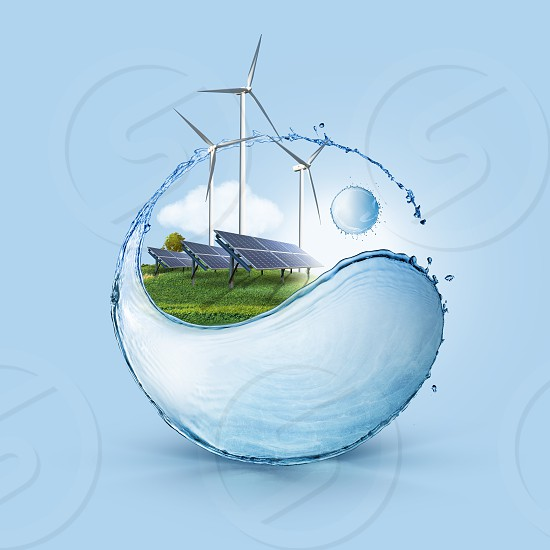 Windmill and solar panels on the field in yin yang shape water splash against blue sky background. Ecology concept of clean world used only sustainable green energy. photo