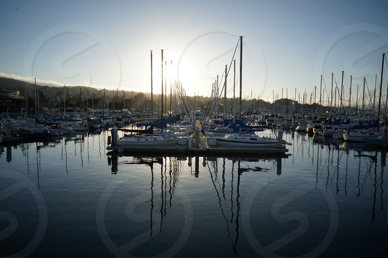 Monterey boats sunset reflection simple views July  photo