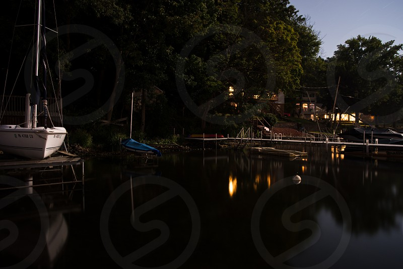 lake dock night water lights calm  photo