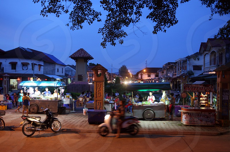 a evening on the nightmarket in the old town of Tha Khaek in central Lao in the region of Khammuan in Lao in Souteastasia. photo