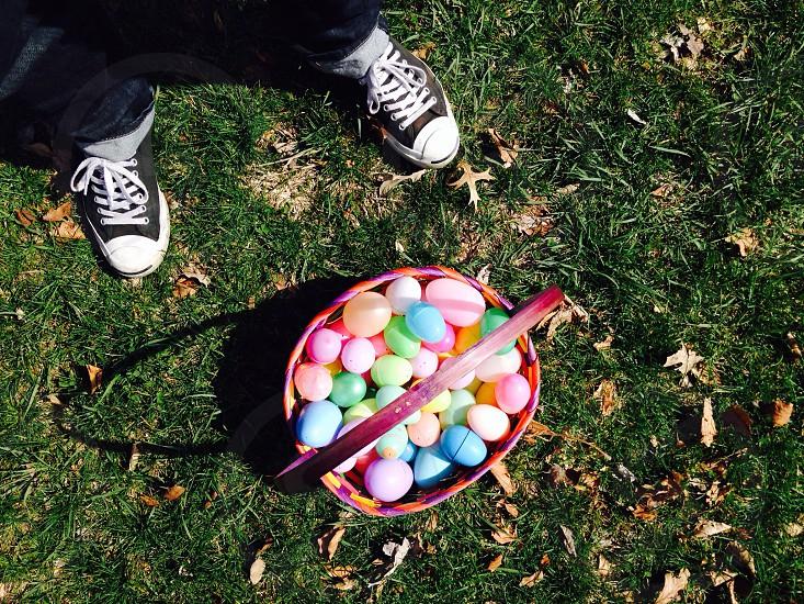 multicolored plastic eggs on basket photo