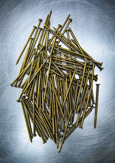 Still life of nails on metallic surface photo