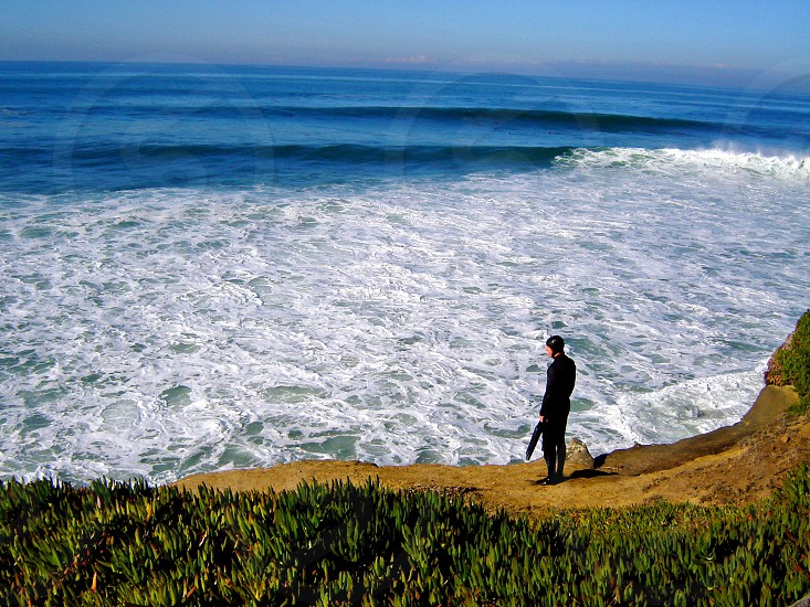 La Jolla diver looks out at the waves photo